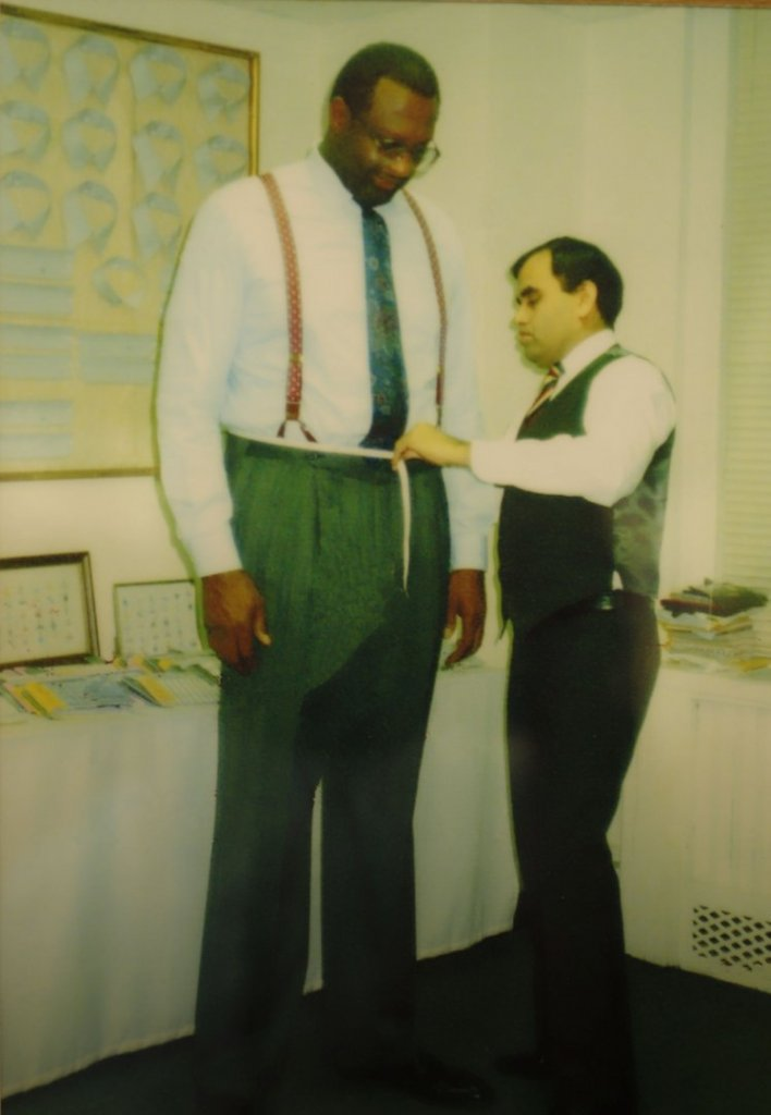 """Big Bob"" Lanier, NBA Hall of Famer, being fitted for a suit by Mr. Mohan."